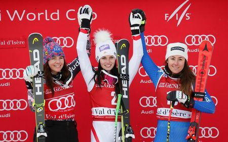 Alpine Skiing - Women's Alpine Skiing World Cup Super G - Val d´Isere, France - December 17, 2017 Austria's Anna Veith celebrates winning the Women's Super G on the podium with second placed Tina Weirather of Liechtenstein and third placed Sofia Goggia of Italy REUTERS/Robert Pratta