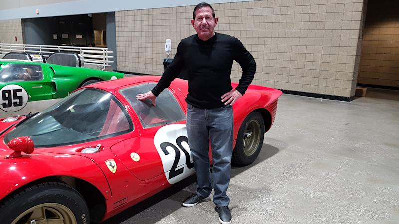 """Peter Toundas, president of Championship Auto Shows, standing with the Ferrari used in the making of """"Ford v Ferrari"""" that will appear at Autorama in Detroit in 2020. He is pictured with the vehicle on Feb. 18, 2020 at a show in Kansas City, Missouri."""