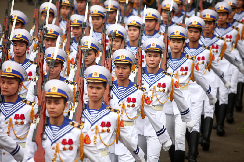 Vietnamese Navy's honor guard arrive at the welcome ceremony for Myanmar President Thein Sein in Hanoi, Vietnam on Tuesday, March 20, 2012. Myanmar President Thein Sein has arrived in Vietnam for his two day official visit on Tuesday. (AP Photo/Na Son Nguyen)