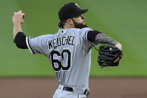 Chicago White Sox' Dallas Keuchel throws in the first inning during a baseball game against the Cincinnati Reds in Cincinnati, Saturday, Sept. 19, 2020. (AP Photo/Aaron Doster)