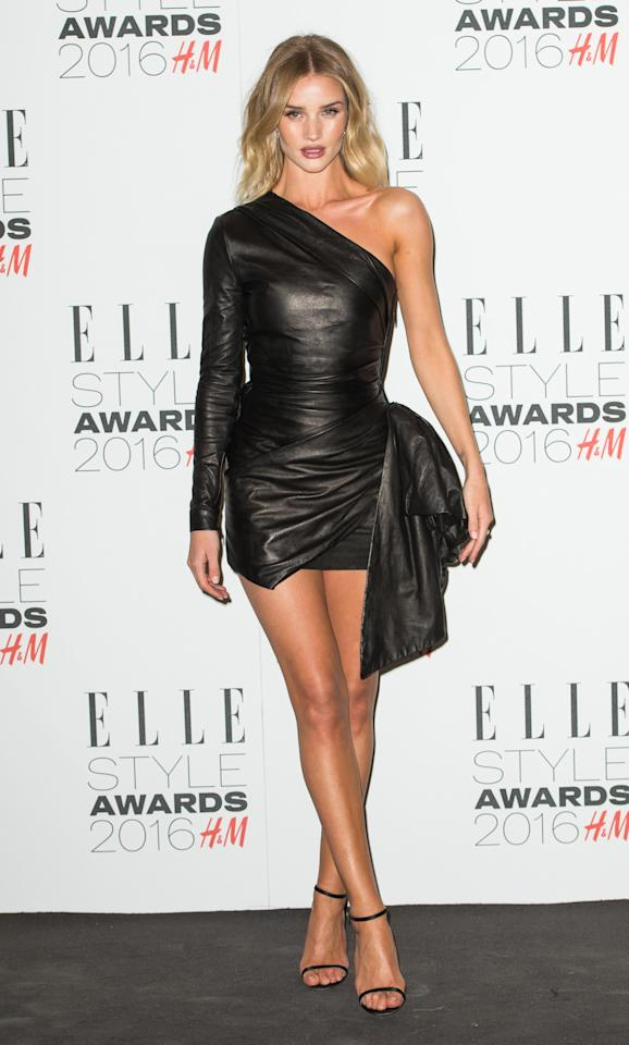 <p>The model wore a leg-baring, one-sleeved, skin-tight leather number that was tied together with a bow at her hip. (<i>Photo: Getty Images</i>)</p>