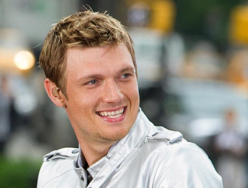 "FILE - This May 24, 2010 file photo shows Nick Carter of the Backstreet Boys performing on CBS News' ""The Early Show"" in New York. The Backstreet Boys singer proposed to his fitness trainer girlfriend Lauren Kitt in February, and he says they may bring their marriage to the small screen. ""There have been offers and opportunities to film the actually wedding, like a TV show,"" the 33-year-old said in a recent interview. The couple appears together in a series of fitness webisodes called ""Kit Fitt."" (AP Photo/Charles Sykes, file)"