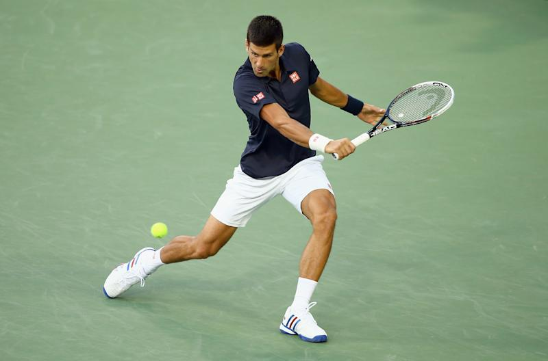 Novak Djokovic of Serbia hits a return to Gilles Simon of France during the Western & Southern Open, at the Lender Family Tennis Center in Cincinnati, Ohio, on August 12, 2014