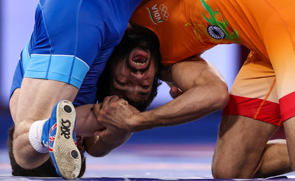 CHIBA, JAPAN - AUGUST 5, 2021: Indias Kumar Ravi in the men's freestyle 57kg final wrestling bout against ROC's Zaur Uguev at the 2020 Summer Olympic Games, at the Makuhari Messe convention center. Stanislav Krasilnikov/TASS (Photo by Stanislav Krasilnikov\TASS via Getty Images)