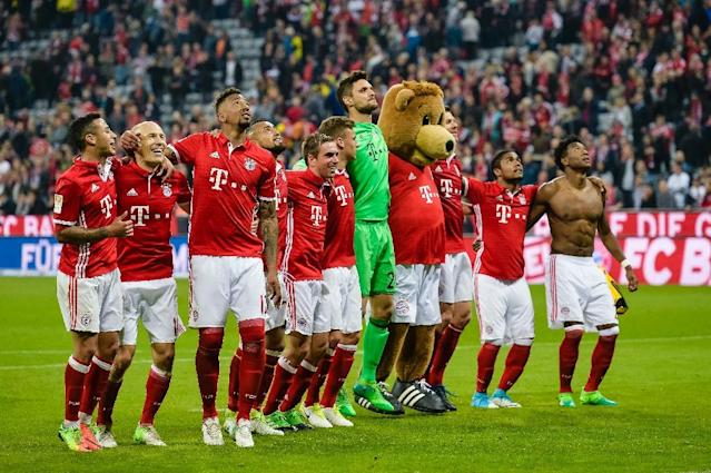 The players of Bayern Munich celebrate their victory after the German first division Bundesliga football match FC Bayern Munich v BVB Borussia Dortmund in Munich, southern Germany, on April 8, 2017 (AFP Photo/Guenter SCHIFFMANN)