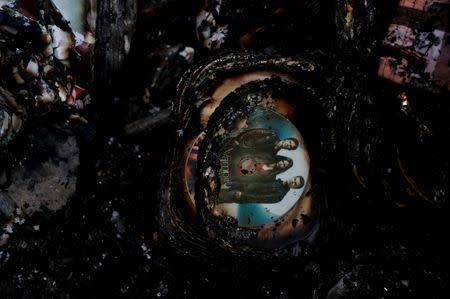 Partially burnt dvd's are seen inside a gutted house after a fire at a residential district in Pasig, Metro Manila, Philippines, May 5, 2018. REUTERS/Erik De Castro