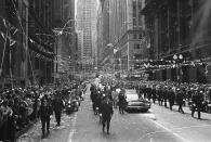 FILE - In this May 1, 1970 file photo, confetti falls from the skyscrapers in Chicago's financial district as Apollo 13 astronauts John Swigert and Jim Lovell ride in a motorcade during a parade in their honor. (AP Photo)