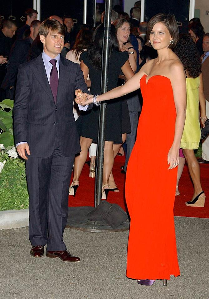 """Tom Cruise shows off his lovely (and much taller) lady love. Gregg DeGuire/<a href=""""http://www.wireimage.com"""" target=""""new"""">WireImage.com</a> - July 22, 2007"""