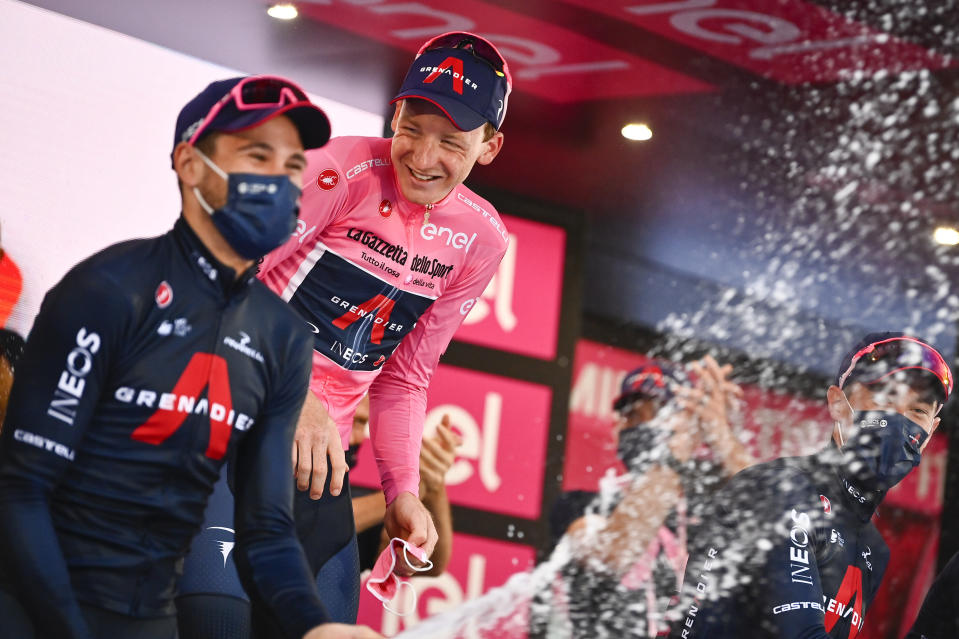 Britain's Tao Geoghegan Hart celebrates with teammates after winning the Giro d'Italia cycling race, in Milan, Italy, Sunday, Oct. 25, 2020. In one of the most exciting final stages of a Grand Tour, British rider Tao Geoghegan Hart won the Giro d'Italia on Sunday, edging out Australian Jai Hindley by just 39 seconds. (Marco Alpozzi/LaPresse via AP)