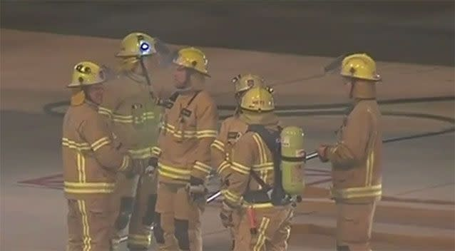 Maintenance crews and emergency workers gather on the tarmac. Photo: 7 News