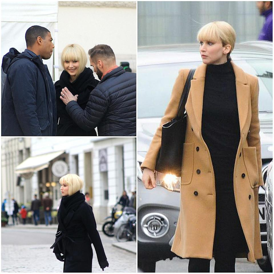 """<p><b>When: April 29/May 3, 2017</b><br>Jennifer Lawrence was spotted rocking thick, blunt blonde bangs while filming the spy thriller """"Red Sparrow"""" on set in Vienna, Austria and at Heathrow Airport in London. The 26-year-old is portraying Dominika Egorova, a Russian spy assigned to operate against a young CIA officer. Lawrence has been growing out her pixie cut from 2013, so the new 'do could possibly be a wig — but she's totally giving us bang envy! <i>(Photo: Splash) </i> </p>"""