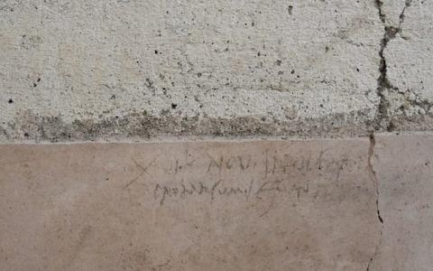 The inscription, in charcoal, was written in October AD 79 - meaning Vesuvius erupted three months later than previously thought - Credit: Pompeii