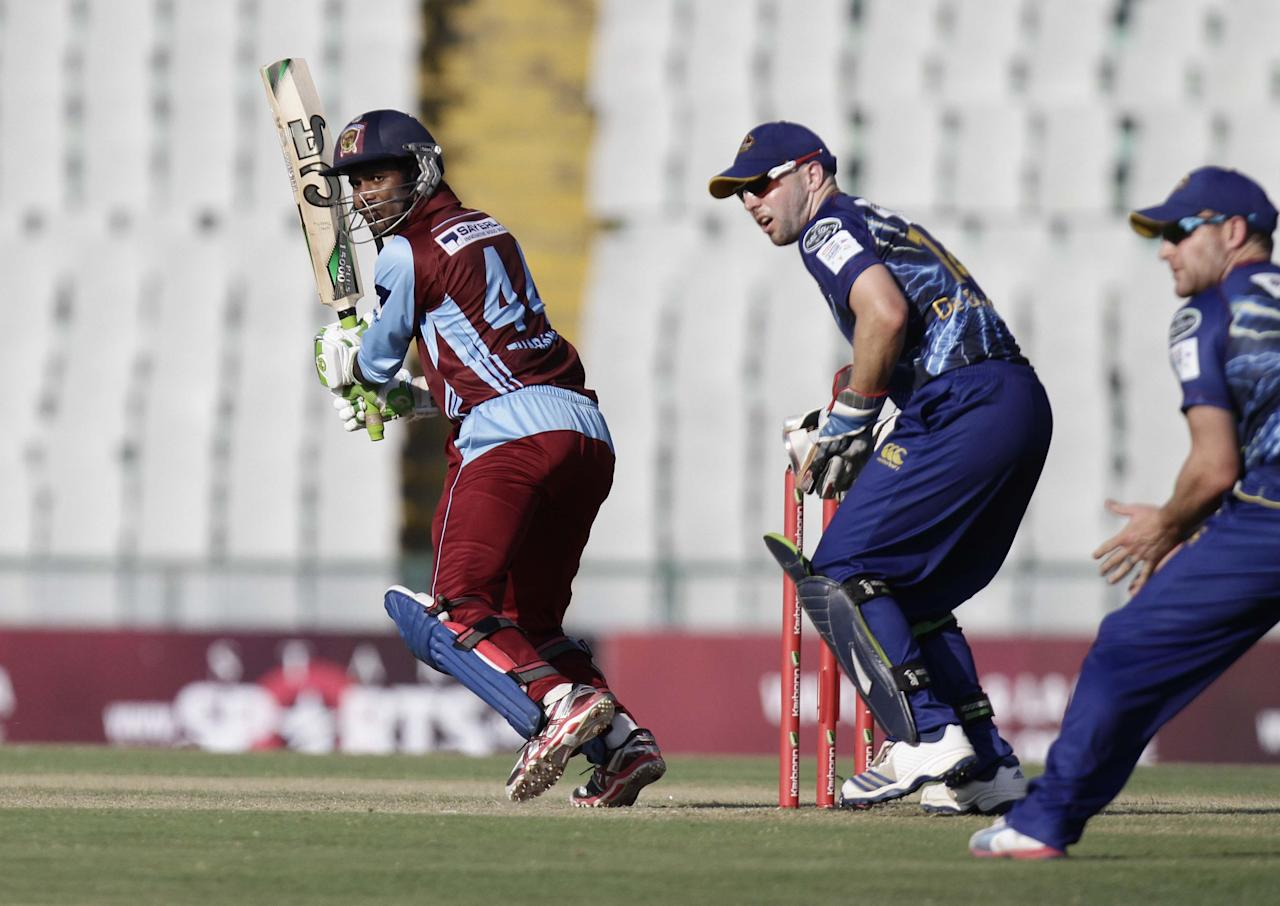 W U Tharanga in action during the Champions League T20, 3rd Match between Kandurata Maroons and Otago Volts at Mohali stadium, Chandigarh on Sept. 18, 2013. (Photo: IANS)
