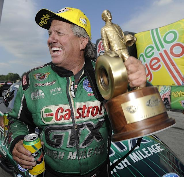 In this photo provided by the NHRA, Funny Car icon John Force celebrates after his victory Sunday, July 6, 2014, at the Summit Racing Equipment NHRA Nationals at Norwalk, Ohio. Force outran longtime rival Ron Capps to earn his 140th career victory and second win of the NHRA Mello Yello Drag Racing Series season. It was his first win at Summit Motorsports Park. (AP Photo/NHRA, Marc Gewertz)
