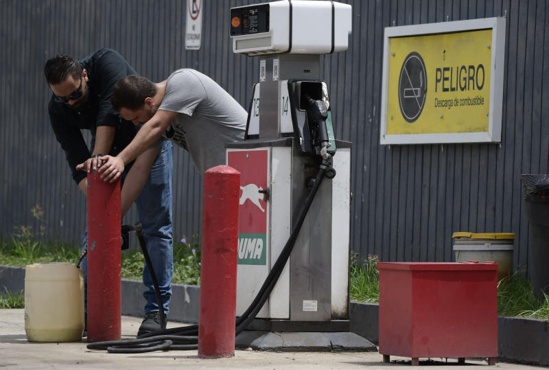 Citizens stock up on gasoline a few hours before the passing of tropical storm Dorian, in Canovanas, Puerto Rico, Aug. 28, 2019. (Photo: Carlos Giusti/AP)