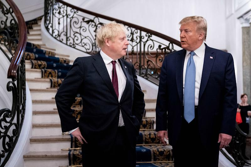 US President Donald Trump (R) and Britain's Prime Minister Boris Johnson speak before a working breakfast at the G7 Summit in Biarritz, France on August 25, 2019, on the second day of the annual G7 Summit attended by the leaders of the world's seven richest democracies, Britain, Canada, France, Germany, Italy, Japan and the United States. (Photo by Erin Schaff / POOL / AFP) (Photo credit should read ERIN SCHAFF/AFP/Getty Images)