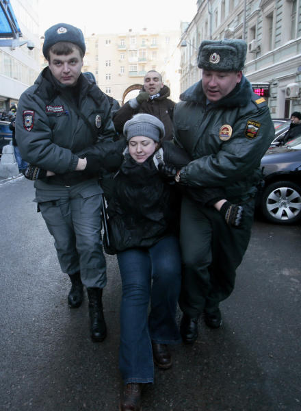 """Police detain a gay rights activist during a protest near the State Duma, Russia's lower parliament chamber, in Moscow, Russia, Friday, Jan. 25, 2013. A controversial bill banning """"homosexual propaganda"""" has been submitted to Russia's lower house of parliament for the first of three hearings on Friday. Twenty people were detained according to a police report. (AP Photo/Mikhail Metzel)"""