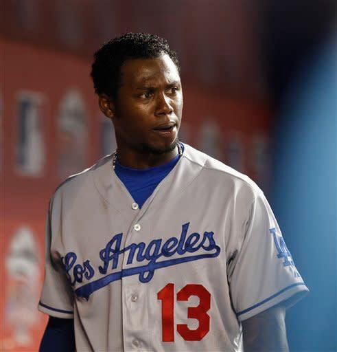 Los Angeles Dodgers player Hanley Ramirez walks around the dugout during the first inning of a baseball game in Miami, Friday, Aug. 10, 2012 against the Miami Marlins. (AP Photo/J Pat Carter)