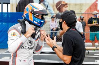 <em>Ricky Taylor celebrates his pole position with teammate Helio Castroneves (IMSA).</em>