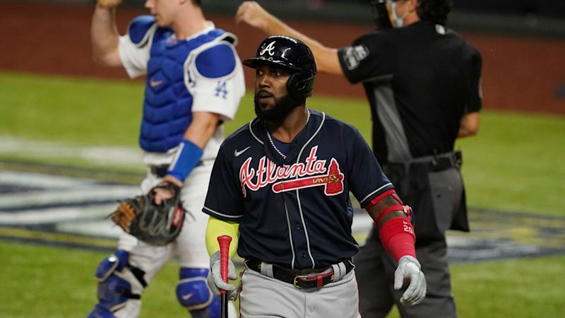 Mandatory Credit: Photo by Tony Gutierrez/AP/Shutterstock (10964348cy)Atlanta Braves' Marcell Ozuna walks to the dugout after striking out during the sixth inning in Game 7 of a baseball National League Championship Series against the Los Angeles Dodgers, in Arlington, TexasNLCS Braves Dodgers Baseball, Arlington, United States - 18 Oct 2020.