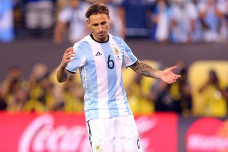 Jun 26, 2016; East Rutherford, NJ, USA; Argentina midfielder Lucas Biglia (6) reacts after missing a penalty kick during penalty kicks of the championship match of the 2016 Copa America Centenario soccer tournament at MetLife Stadium. Chile won 0-0 (4-2). Mandatory Credit: Brad Penner-USA TODAY Sports  / Reuters  Picture Supplied by Action Images