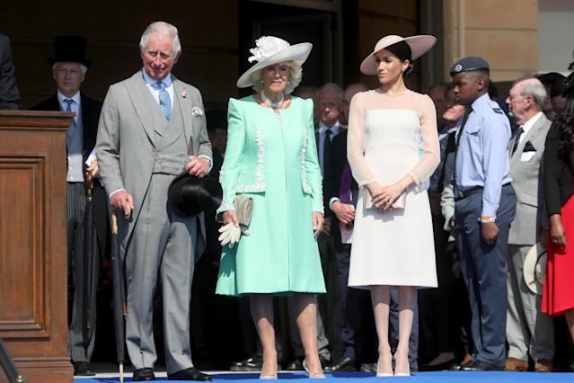 The Duchess of Sussex with Prince Charles and Camilla, the Duchess of Cornwall. (Photo: Getty Images)