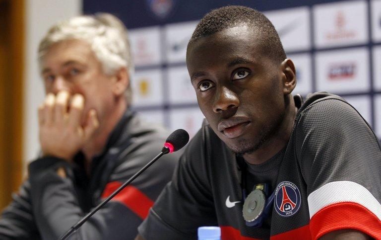 PSG midfielder Blaise Matuidi holds a joint press conference with coach Carlo Ancelotti in Doha on December 29, 2012