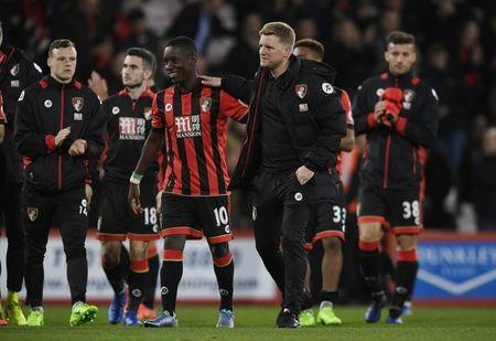 Britain Football Soccer - AFC Bournemouth v Swansea City - Premier League - Vitality Stadium - 18/3/17 Bournemouth manager Eddie Howe celebrates after the game with Max Gradel  Action Images via Reuters / Tony O'Brien Livepic