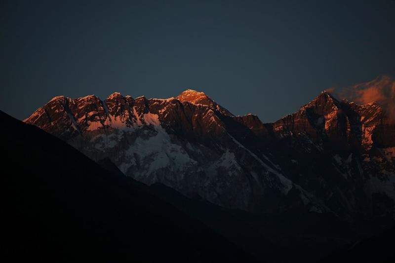 In this Thursday, Feb. 18, 2016, photo, Mount Everest, center, and Mount Lhotse, right, are seen from Tengboche, Nepal. Nepal has extended the permits of climbers who were unable to climb Mount Everest last year due to an earthquake-triggered avalanche that killed 19 people at a base camp in hopes of bringing back western climbers to the world's highest peak. Mountaineering Department official Gyanendra Shrestha said Tuesday, Marh 1 that the climbers can attempt to climb the world's tallest peak this year or next year without paying new fees. (AP Photo/Tashi Sherpa)