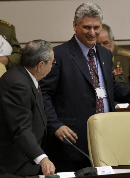 Cuba's new Vice President Miguel Diaz-Canel, right, smiles at Cuba's President Raul Castro, during the closing session at the National Assemby in Havana, Cuba, Sunday, Feb. 24, 2012. Castro accepted a new five-year term that will be, he said, his last as Cuba's president and tapped rising star Miguel Diaz-Canel, 52, as vice president and first in the line of succession. Diaz-Canel has risen higher than any other Cuban official who didn't directly participate in the 1959 Cuban revolution. (AP Photo/Ismael Francisco, Cubadebate)