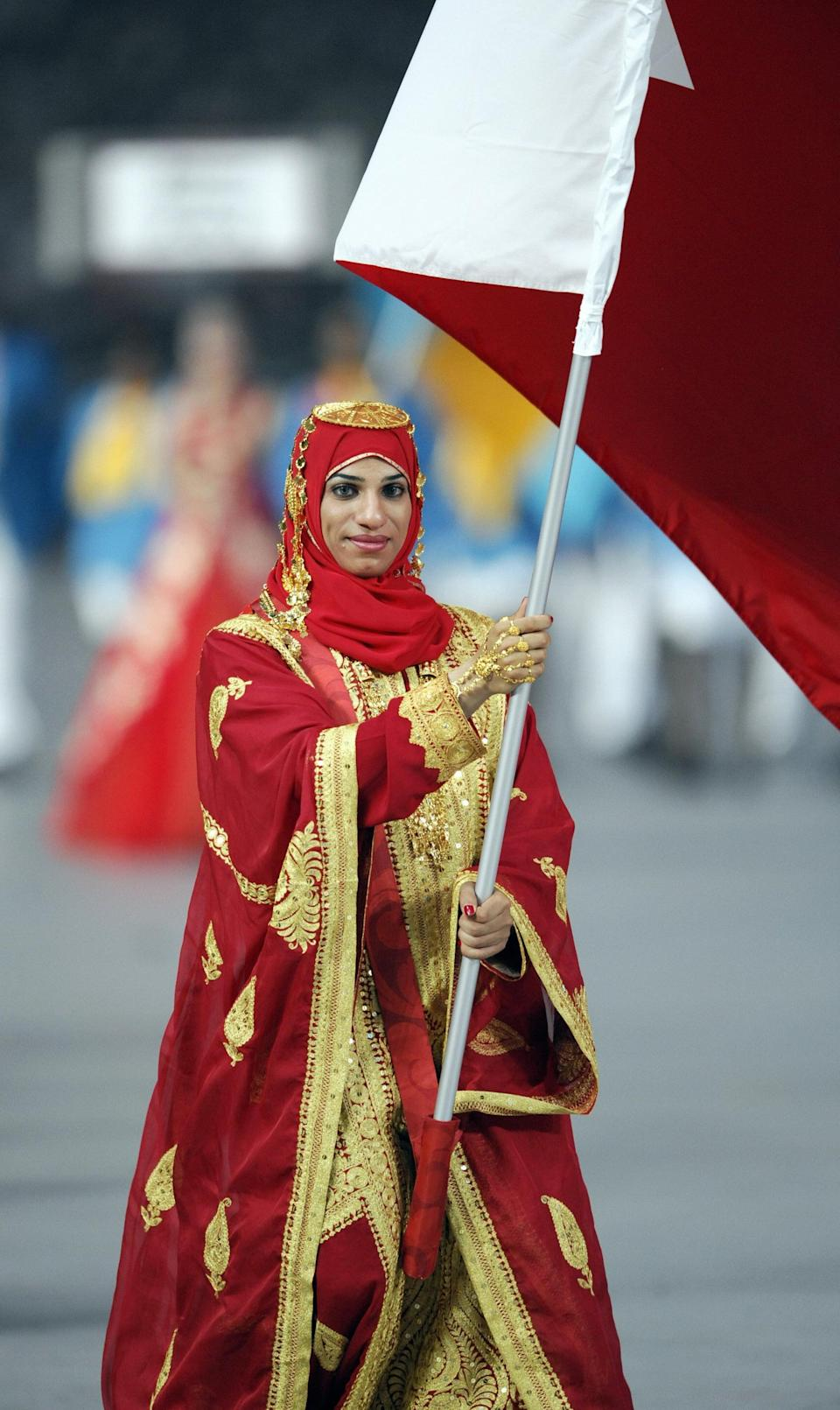 <p>In 2004, Bahraini olympic athlete Roqaya Al-Ghasara was the first woman to run in a headscarf during the 100 meter sprint, but she went on to compete in 2006 and 2008, too. Here, she leads the Olympic delegation of Bahrain at the opening ceremony for the Beijing Olympic Games in her beautiful tailor made outfit with ornate trim and gold sequins.</p>