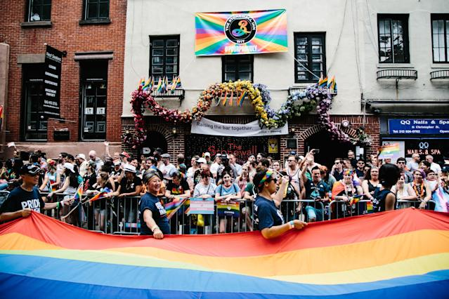 <p>A giant pride flag is displayed by marchers outside the Stonewall Inn during the 49th annual New York City Gay Pride Parade, June 24, 2018. (Photo: Alba Vigaray/EPA-EFE/REX/Shutterstock) </p>