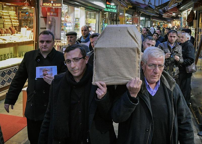 A man holds her photo at the left as people carry the casket of murdered New York woman Sarai Sierra from the Surp Yerrortutyun church to an ambulances in Istanbul, Turkey, Wednesday, Feb. 6, 2013. Sierra, a 33-year-old mother of two, went missing while vacationing alone in Istanbul. Her body was discovered late Saturday amid the city historical walls. Her body is expected to be sent back home, New York, on Thursday.  (AP Photo )