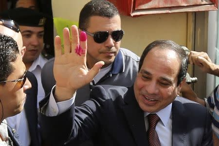 Presidential candidate and former army chief Sisi gestures after casting ballot in Cairo