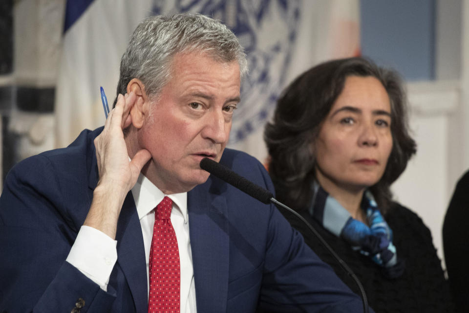 New York City Mayor Bill De Blasio, left, and Dr. Oxiris Barbot, commissioner of the NYC Department of Health and Hygiene, during a press conference on March 19, 2020. / Credit: Mark Lennihan / AP