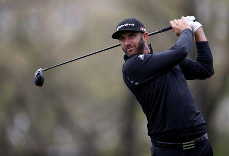May 14, 2019; Farmingdale, NY, USA; Dustin Johnson plays his shot from the 12th tee during a practice round for the PGA Championship golf tournament at Bethpage State Park - Black Course. Mandatory Credit: Peter Casey-USA TODAY Sports