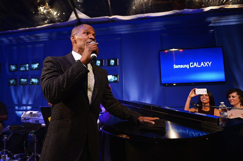 NEW ORLEANS, LA - FEBRUARY 02:  Jamie Foxx performs at the Samsung Galaxy Shangri-La Party in the Big Easy with the New Orleans Preservation Hall Jazz Band on February 2, 2013 in New Orleans, Louisiana.  (Photo by Michael Loccisano/Getty Images for Samsung)