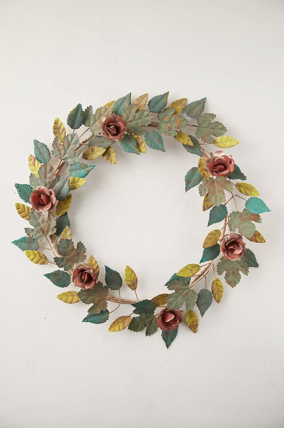 """<p><strong>Terrain</strong></p><p>anthropologie.com</p><p><strong>$78.00</strong></p><p><a href=""""https://go.redirectingat.com?id=74968X1596630&url=https%3A%2F%2Fwww.anthropologie.com%2Fshop%2Frose-leaf-iron-wreath&sref=https%3A%2F%2Fwww.housebeautiful.com%2Fdesign-inspiration%2Fg21287611%2Ffall-door-decorations%2F"""" rel=""""nofollow noopener"""" target=""""_blank"""" data-ylk=""""slk:BUY NOW"""" class=""""link rapid-noclick-resp"""">BUY NOW</a></p><p>This iron and rose wreath boasts a nice aged patina, giving it an old-time-y and sweet feel that will beautify your door for fall and beyond so you can reuse it. </p>"""