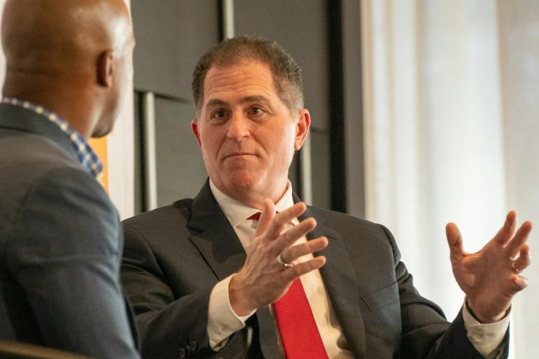 CEO and founder of Dell Technologies, Michael Dell (R, pictured 2019), has been seeking to re-energize the firm, which fell behind when consumers turned to mobile devices instead of PCs (AFP Photo/David Dee Delgado)