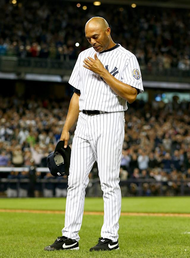 NEW YORK, NY - SEPTEMBER 26: Mariano Rivera #42 of the New York Yankees salutes the fans after he is pulled from the game in the ninth inning against the Tampa Bay Rays on September 26, 2013 at Yankee Stadium in the Bronx borough of New York City. (Photo by Elsa/Getty Images)