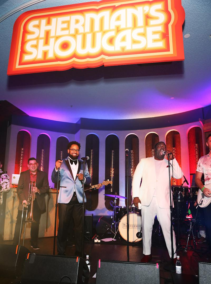 "LOS ANGELES, CALIFORNIA - JULY 30: Diallo Riddle (L) and Bashir Salahuddin perform onstage during ""Sherman's Showcase"" Premiere Party on July 30, 2019 in Los Angeles, California. (Photo by Jesse Grant/Getty Images for AMC)"