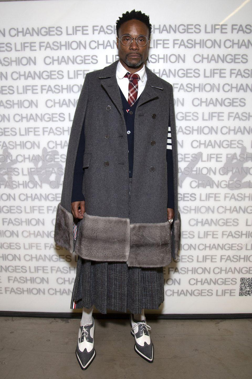 <p>The actor wore an all-grey school uniform-inspired look by Thom Browne to the Fashion Changes Lives event. The star styled the look with an oversize grey cape, navy blue cardigan, grey pleated skirt, grey and white lace-up brogues, white shirt and red tie. </p>