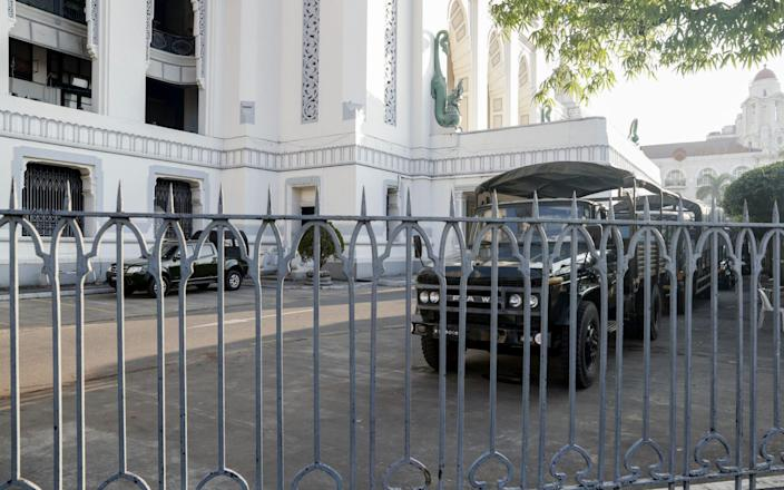 Military trucks are seen inside Yangon City Hall, which is now under the control of the Myanmar military - EPA