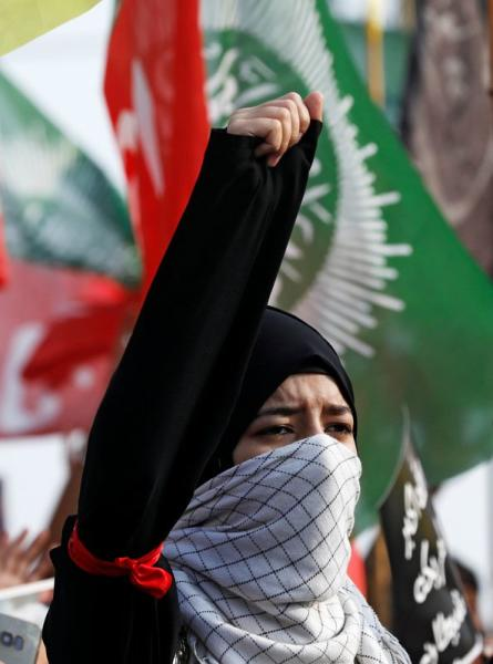 A Pakistani Shi'ite Muslim chant slogans with others to protest the death of Iranian military commander Qassem Soleimani, who was killed in a airstrike near Baghdad, as they march on a road leading towards the U.S. consulate in Karachi