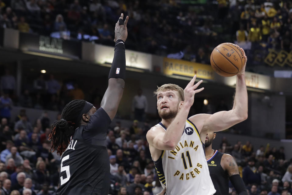 Indiana Pacers' Domantas Sabonis (11) shoots over Los Angeles Clippers' Montrezl Harrell (5) during the second half of an NBA basketball game, Monday, Dec. 9, 2019, in Indianapolis. The Clippers won 110-99. (AP Photo/Darron Cummings)
