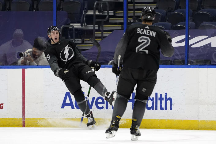 Tampa Bay Lightning left wing Ross Colton (79) celebrates his goal against the Detroit Red Wings with defenseman Luke Schenn (2) during the first period of an NHL hockey game Saturday, April 3, 2021, in Tampa, Fla. (AP Photo/Chris O'Meara)