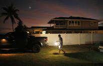 <p>Jay Kitashima loads up his truck after securing his tiny home in preparation for Hurricane Lane, Wednesday, Aug. 22, 2018, along Ewa Beach in Honolulu. (Photo: John Locher/AP) </p>