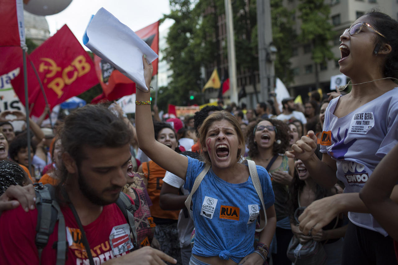 <p>Demonstrators protest government proposed changes to work rules and pensions in Rio de Janeiro, Brazil, Wednesday, March 15, 2017. Critics say the changes would reduce job security for Brazilian workers and the pension proposal would force many people to work longer to qualify for pensions and reduce retirement benefits for many. (Leo Correa/AP) </p>