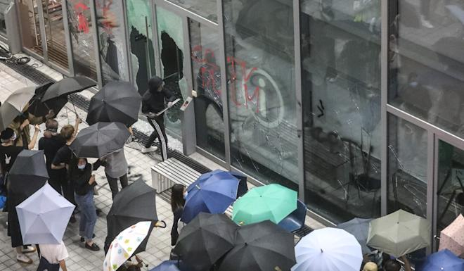 Vandals strike at HKDI on Monday over unreleased footage concerning a girl's death, which police say was not suspicious. Photo: Dickson Lee