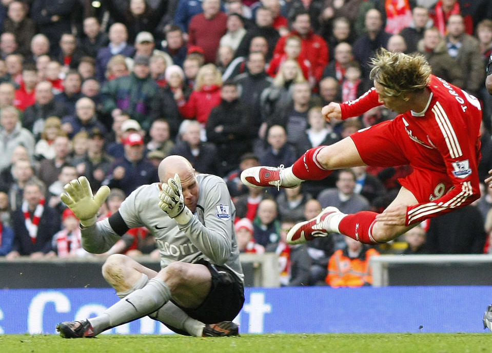"""Liverpool's Fernando Torres (R) is fouled by Aston Villa's Brad Friedel (L) to win a penalty during their English Premier League soccer match in Liverpool, March 22, 2009. REUTERS/Phil Noble (BRITAIN SPORT SOCCER IMAGE OF THE DAY TOP PICTURE) FOR EDITORIAL USE ONLY. NOT FOR SALE FOR MARKETING OR ADVERTISING CAMPAIGNS. NO USE WITH UNAUTHORIZED AUDIO, VIDEO, DATA, FIXTURE LISTS, CLUB/LEAGUE LOGOS OR """"LIVE"""" SERVICES. ONLINE IN-MATCH USE LIMITED TO 45 IMAGES, NO VIDEO EMULATION. NO USE IN BETTING, GAMES OR SINGLE CLUB/LEAGUE/PLAYER PUBLICATIONS"""